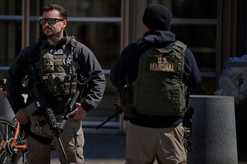 U.S. Marshals stand outside U.S. Federal Court in Brooklyn during the arraignment on terrorism charges of two Queens women, identified as 28-year-old Noelle Velentzas and 31-year-old Asia Siddiqui, as well as American citizen and accused Al Queda member Muhanad Mahmoud al Farekh, 29, on April 2, in New York City.