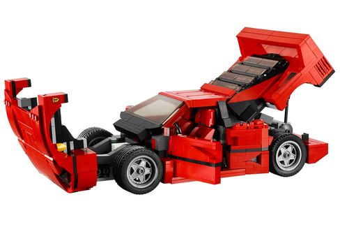Both the hood and rear hatch open to reveal a tool compartment and the engine.