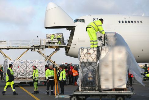 Workers load a shipment on to a Boeing 747 cargo plan.