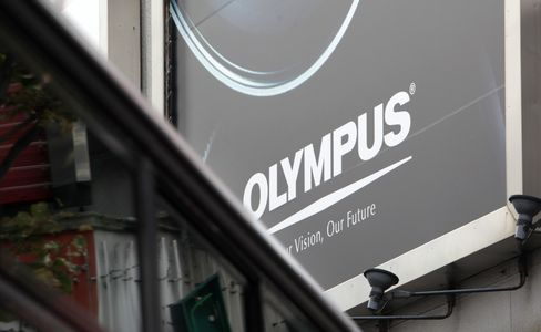 Olympus Ex-Director Petitions Employees