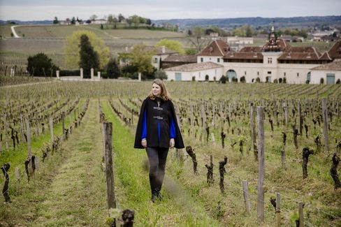 Stéphanie de Boüard-Rivoal, managing director at Château Angelus, walks between the vines in the vineyard at her château in Saint-Émilion, France. She is of the eighth generation—and the third woman—to run the estate.