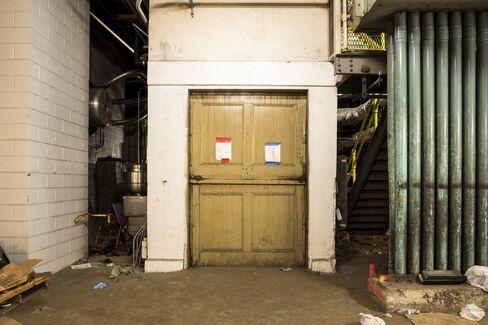 Evacuation protocols taped onto the elevator doors.