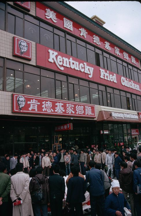 A crowd gathers for the grand opening of China's first Kentucky Fried Chicken restaurant near Tiananmen Square in 1987.