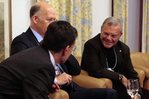 Eric Cantor, left, Donald Baer, center, and Martin Sorrell speak at Davos.