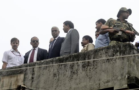 Ajit Doval, second from left,and other officers inspect the site of a bomb blast in Burdwan, West Bengal, India in October 2014.