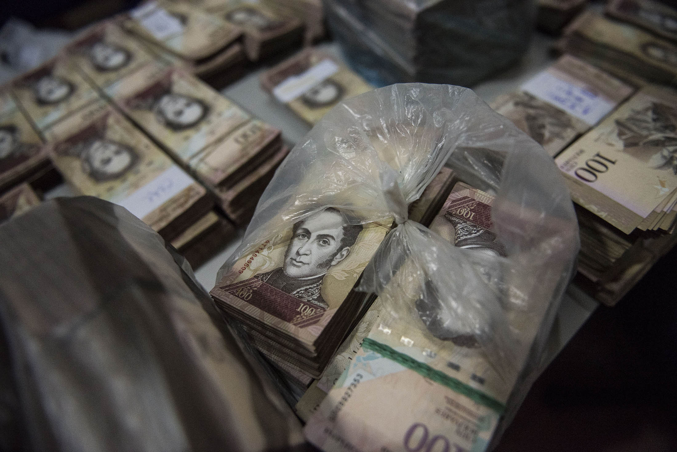 Image result for stacks of venezuelan currency