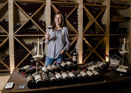 Caroline Frey swirls a glass of her Château La Lagune in the cellar where older vintages are all stored in bins. The 38-year-old once dreamed of a career as an equestrian.