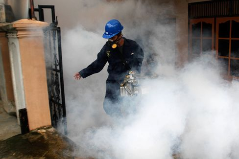 Health workers fumigate a neighborhood in Banda Aceh, Indonesia on August 31.