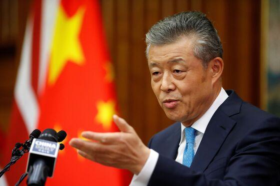 U.K. Huawei Ban Triggers China Warning as Trump Takes Credit