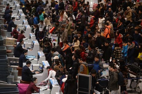 Passengers checking in at the service counters in Beijing Capital International Airport on the first day of China's Spring Festival travel rush last year.