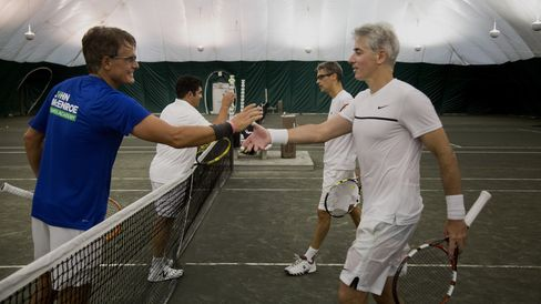 Christer Gardell and Zubin Irani shake hands with Walter Dolhare and Bill Ackman after a match in the Finance Cup