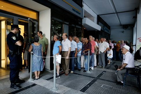 Lines outside of Greek ATMs.