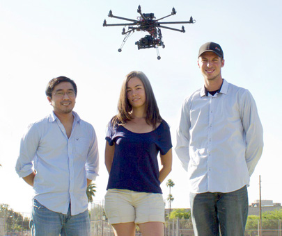 Josh Lambeth, right, with his partners, Darren Ito and Noel Lucas, and their 'octocopter'