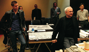 Renowned architect Frank Gehry, right front, who designed the recently-opened Walt Disney Concert Hall in downtown Los Angeles, and actor Brad Pitt, left, listen during a symposium of architects and architectural students discussing the $1.2 billion revitalization plans for downtown Los Angeles, Saturday, March 13, in Los Angeles.  Pitt has a personal interest in architecture. Gehry is part of the architectural team of Bunker Hill LLC, one of five contenders for the massive redevelopment project.  (AP Photo/Howard Pasamanick, Bunker Hill LLC)