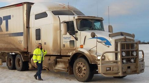 Peggy Biro in Alaska with a Wal-Mart truck and trailer.