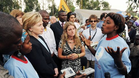 Secretary of State Hillary Clinton listens to a speaker during a visit to a refugee camp on the outskirts of Goma, Democratic Republic of Congo, on Aug. 11, 2009.