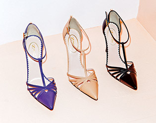 The T-strap pump ($355), offered in purple, nude, and black, is named Carrie in a nod to her stylish character