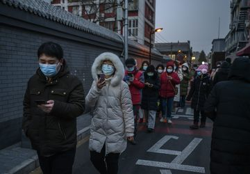 Residents of Dongcheng District in Beijing line up for Covid-19 testing on Jan. 22. China's lockdowns are also getting tougher, rivaling the severity of curbs placed on Wuhan a year ago.