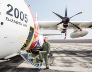 Commander Gabrielle McGrath entering the aircraft where she and her team conduct their missions to search for icebergs in the North Atlantic. Using HC-130J aircraft, their operations are based out of St. John's, Newfoundland, for a nine-day period twice a month.