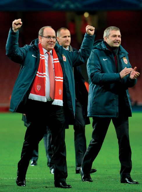 Rybolovlev, right, and Prince Albert II celebrate Monaco FC's win over Arsenal in London on Feb. 25—the same day Bouvier was arrested.
