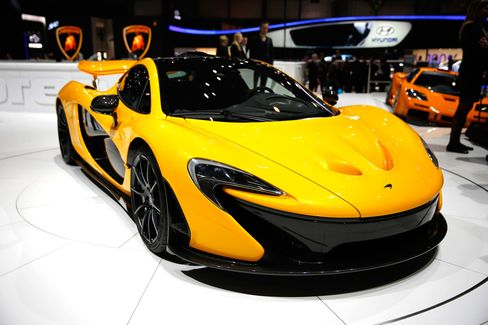 The McLaren P1 was one of the original high-performance hybrid supercars, with a twin-turbo V8 engine and the equivalent of 903 total combined horsepower. Total range on the battery is more than 300 miles; the combined fuel economy when running on gasoline is 17 mpg. The car is limited to 375 units. Price: $1.35 million.