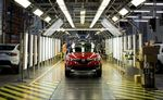 Workers perform quality control inspections on completed Renault Captur crossover sport utility vehicles (SUV) on the production line inside the Renault SA automobile plant in Moscow.