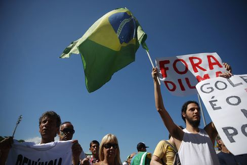 Protesters calling for the impeachment of President Dilma Rousseff march along Copacabana beach on Aug. 16, 2015.