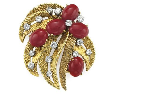 A coral and gold brooch.