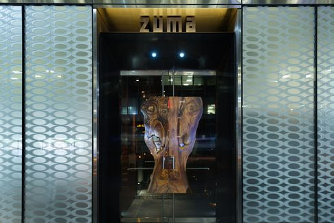 The gleaming, clublike entrance to Zuma in Midtown Manhattan.