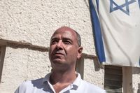 Tamir Gedo, chief executive officer of B.O.L. Pharma, Breath of Life, poses for a photograph beside an Israeli flag in Kfar Pines, Israel, on Wednesday, Sept. 21, 2016. XXX ADD SECOND SENTENCE XXX. Photographer: Rina Castelnuovo/Bloomberg