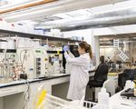 A technician works at the IndieBio laboratory and co-working space in San Francisco. As the life sciences sector booms, the market for lab space in cities like Boston and the Bay Area has heated up.