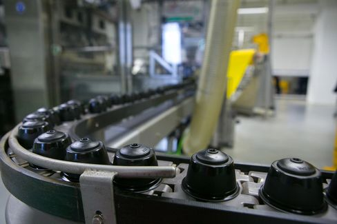 Dolce Gusto capsules pass along the production line at the Nestle factory in Schwerin.