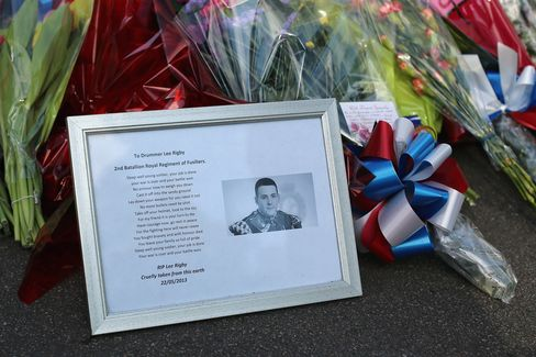 A Photo of Drummer Lee Rigby Lies outside Woolwich Barracks