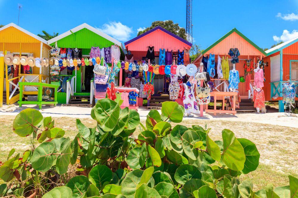 Multi colored wood cottages and tourist souvenir shops, Long Bay Beach, Antigua