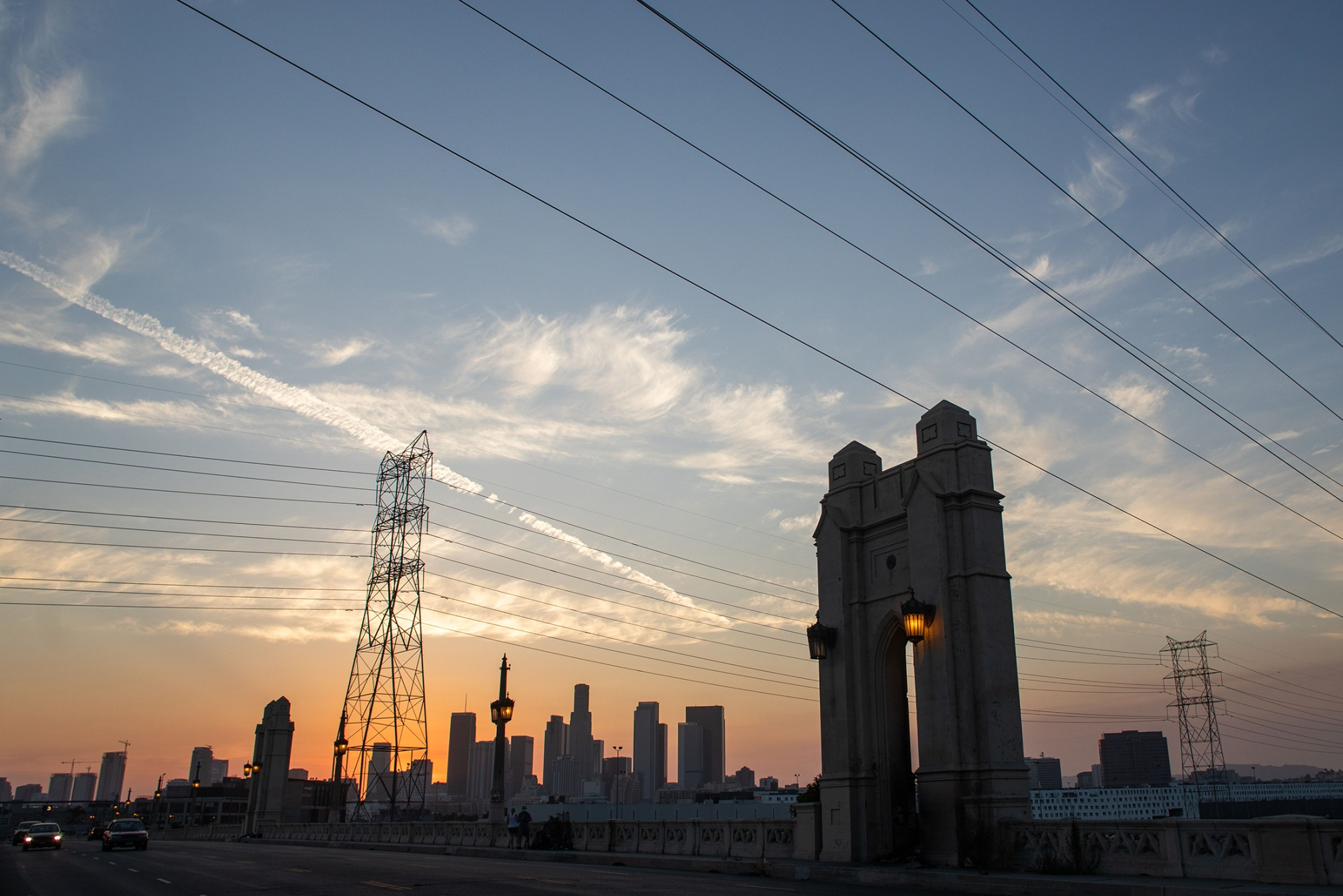 The Los Angeles skyline is seen behind transmission lines on Aug. 16.