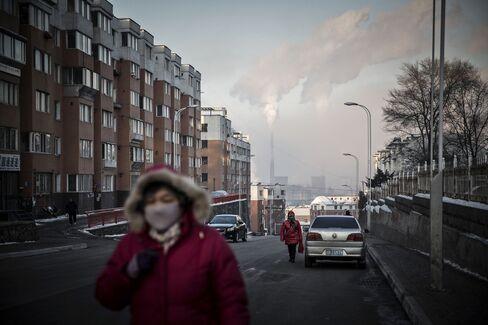 Water vapor and smoke. Phoptographer: Qilai Shen/Bloomberg