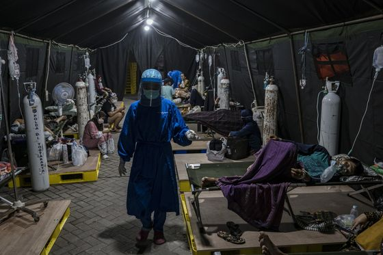 With 50,000 Cases a Day, One Country Opens Up as Another Suffers