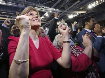 First Minister of Scotland and Scottish National Party leader Nicola Sturgeon celebrates with the results for her party at the count of Glasgow constituencies for the General Election, Glasgow, Scotland, Friday, May 8, 2015. (AP Photo/Scott Heppell)