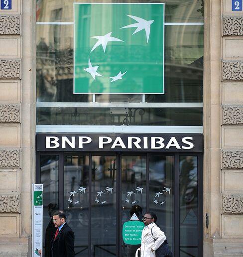 Pedestrians pass a branch of BNP Paribas