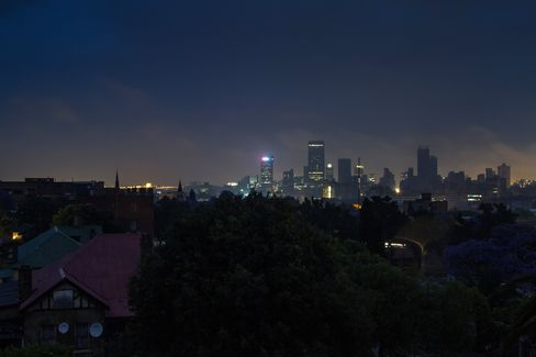 Darkness surrounds residential homes due to a blackout in Johannesburg.