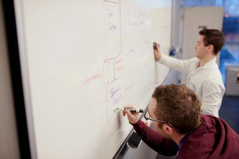 Maluuba employees write out code.