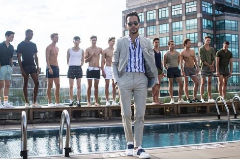 Moti visits a Katama launch event on opening night of New York Fashion Week: Men's at Jimmy at the James Hotel. Khaki suit by Theory, shirt by Bonobos, leather sneakers by Valentino, sunglasses by Garrett Leight (seen in all).