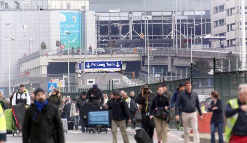 Passengers evacuate the airport.