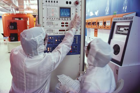 Workers at an Intel Semiconductor Plant