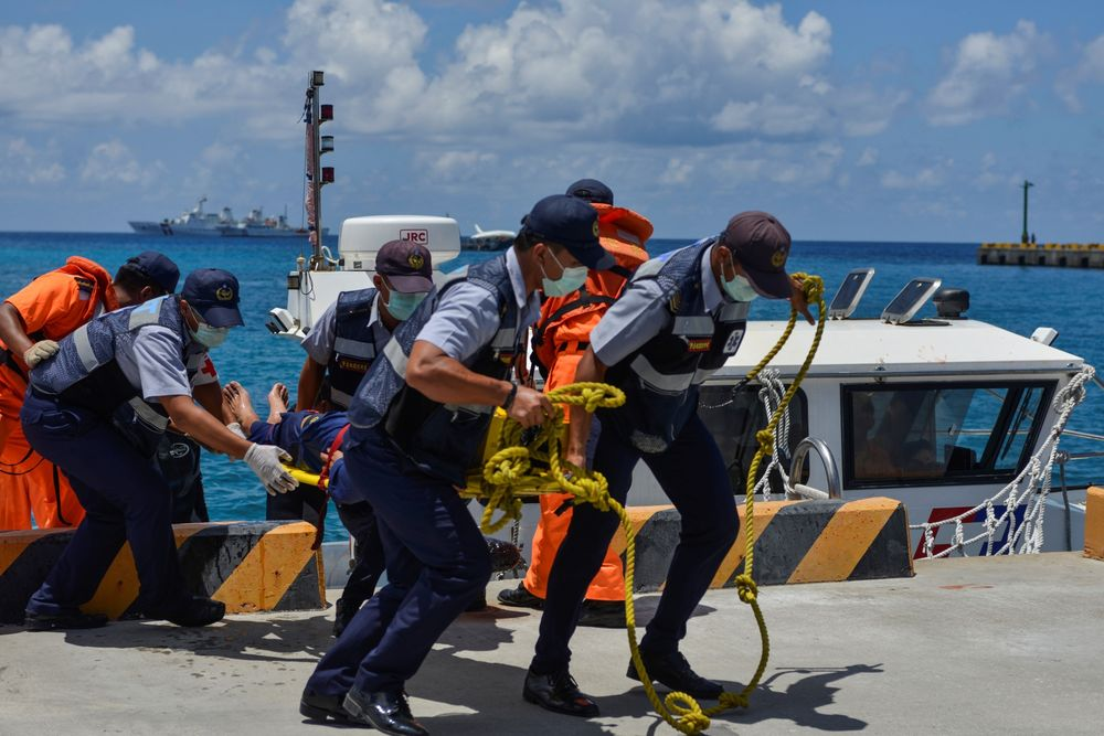 Members of Taiwan's coast guard carry a stretcher off a boat during in a drill in 2019.