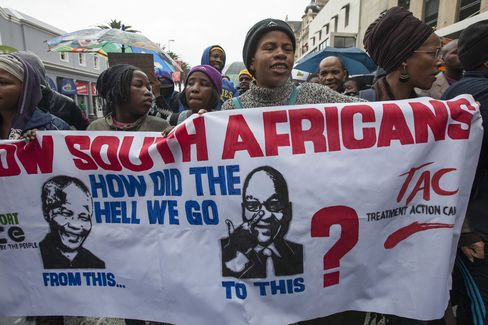 Protestors carry a banner during a march against corruption in Cape Town, on Wednesday, Sept. 30, 2015.