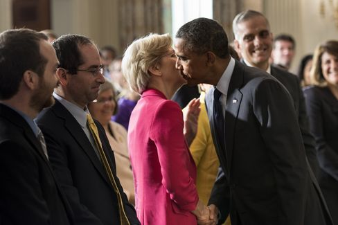 US President Barack Obama leans in to kiss Senator Elizabeth Warren in the White House on July 17, 2013 after speaking about his nomination of Richard Cordray as director of the Consumer Financial Protection Bureau.