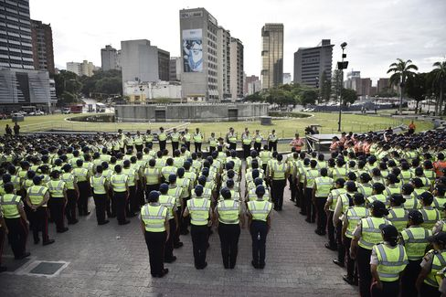 Police stand ahead of the opposition march in Caracas, on Sept. 1.