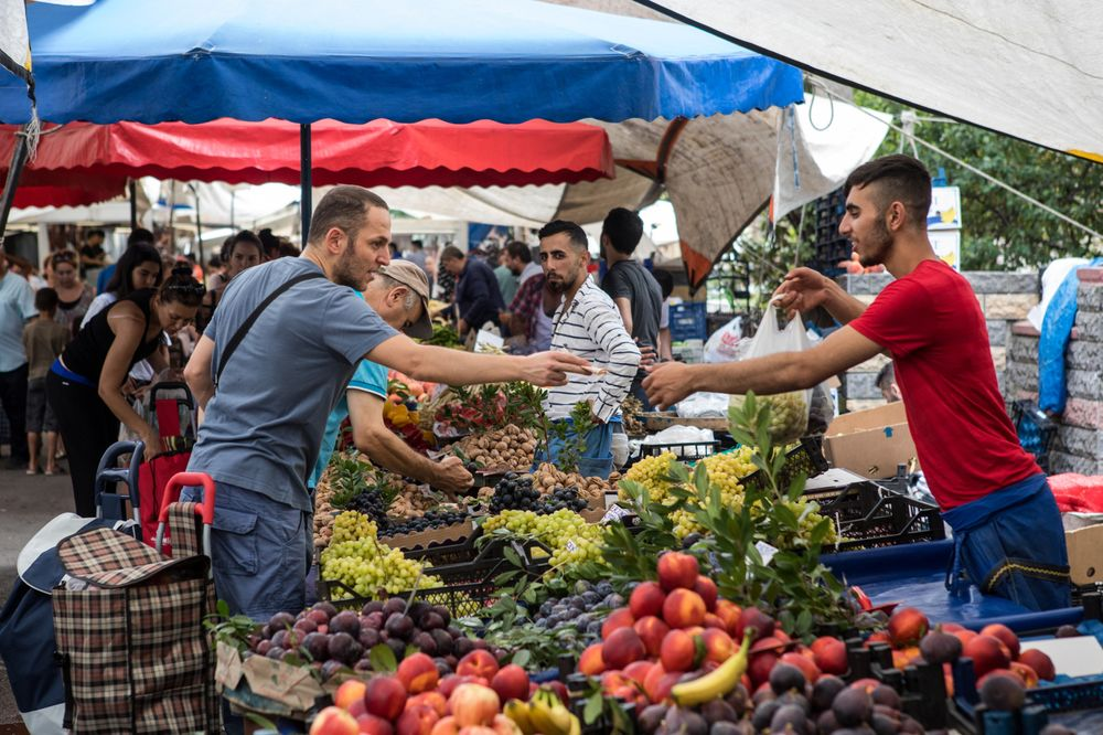 A customer purchases groceries at a market in the Kadikoy district of Istanbul.