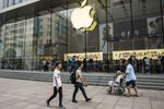 Pedestrians walk past an Apple Inc. store in Shanghai, China, on Friday, July 6, 2018.